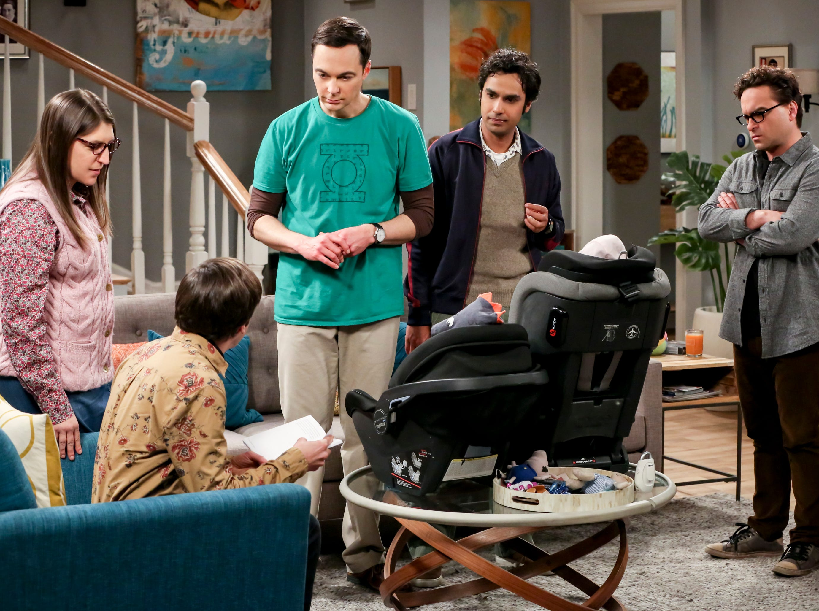 """A scene from Thursday's episode of """"The Big Bang Theory"""" on CBS. Delaware author Shaun Gallagher's book """"Experimenting with Babies"""" is featured prominently."""