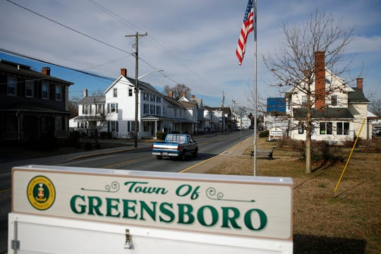 In this Jan. 28, 2019, photo, a motorist drives past a welcome sign in Greensboro, Md. A black teenager's death in police custody roiled this rural town on Maryland's Eastern Shore.
