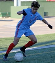 Hirschi's Jose Chavarria keeps the ball inbounds in the match against Graham Tuesday, March 5, 2019, at Memorial Stadium.