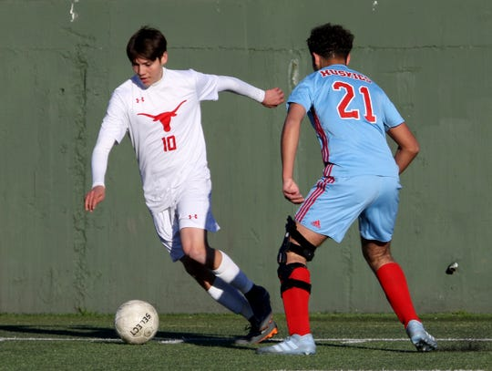 Graham's Greg Simental dribbles by Hirschi's Jacob Vasquez Tuesday, March 5, 2019, at Memorial Stadium.