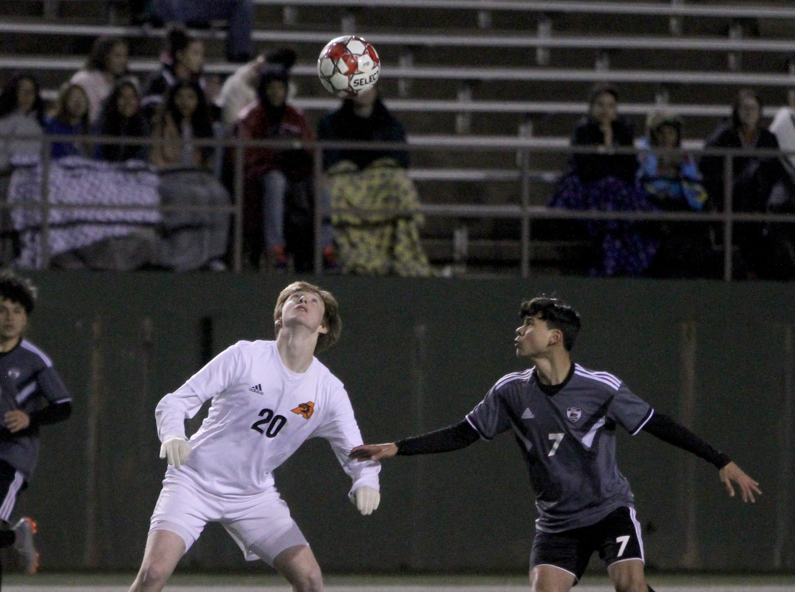 Wichita Falls High School's Daniel Alvarez (7) and Aledo's Austin Jones looks to the ball Tuesday, March 5, 2019, at Memorial Stadium.