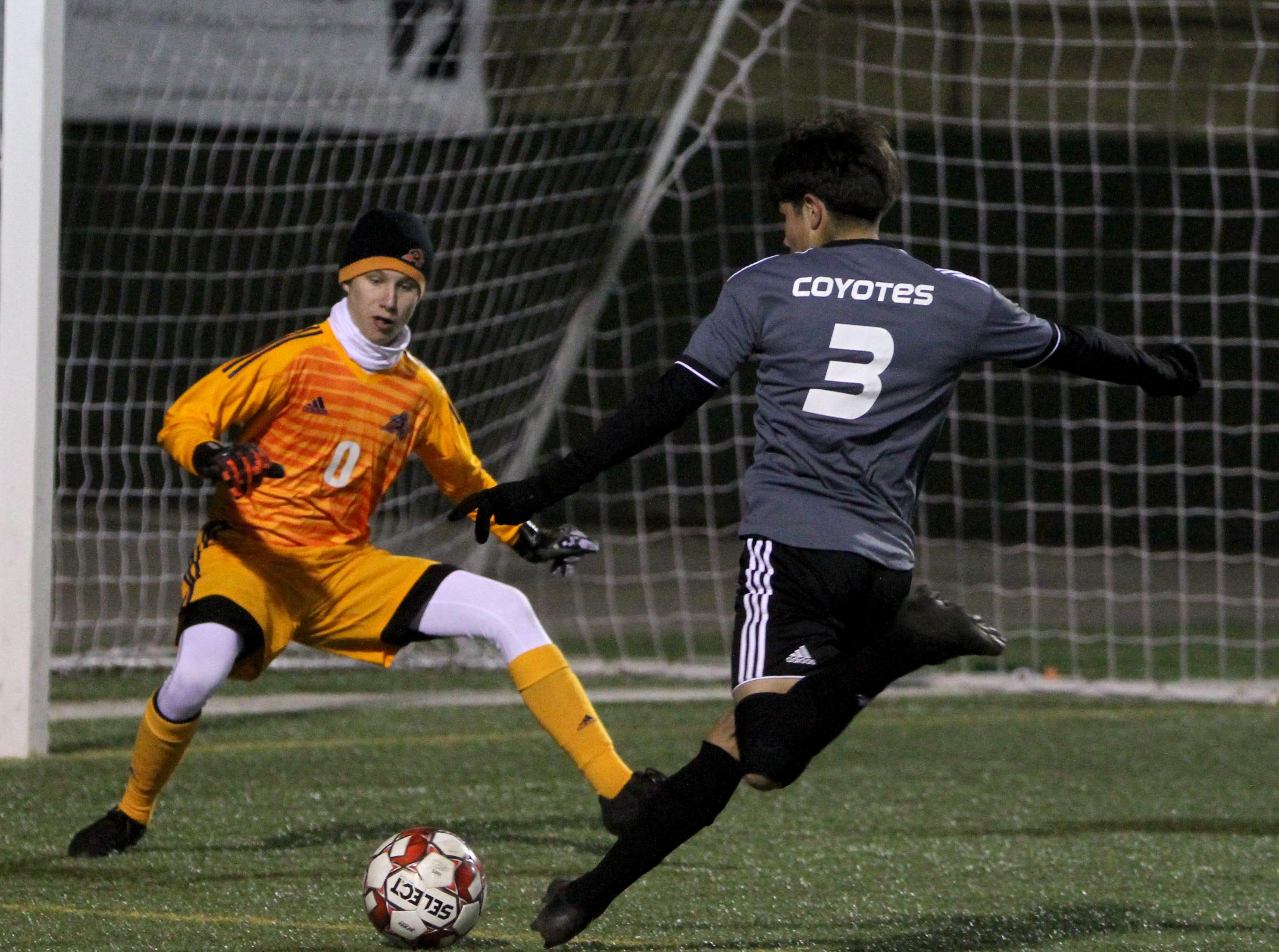 Wichita Falls High School's Taylor Davis fakes a kick by Aledo goalie Ryland Oaks Tuesday, March 5, 2019, at Memorial Stadium.