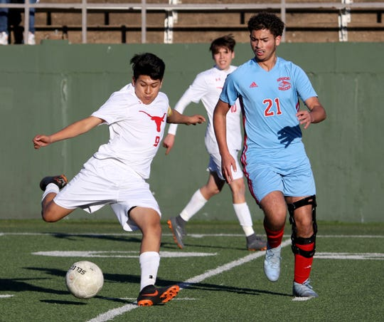 Graham's Alonso Arvizu attempts a shot on the Hirschi goal Tuesday, March 5, 2019, at Memorial Stadium.