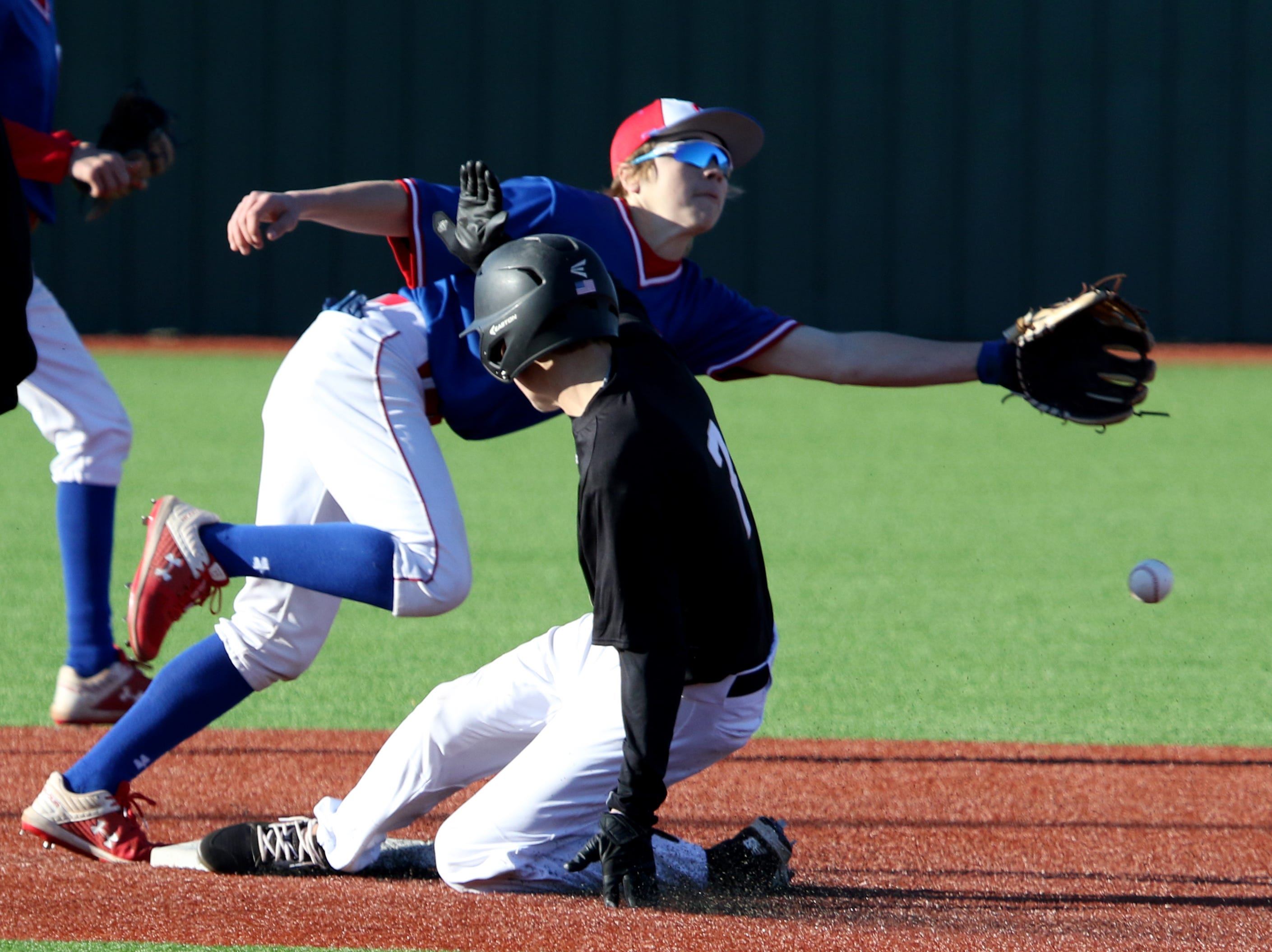 Rider's Max Turner steals second as Abilene Cooper's Brody Stanford reaches for the ball Tuesday, March 5, 2019, at Hoskins Field.