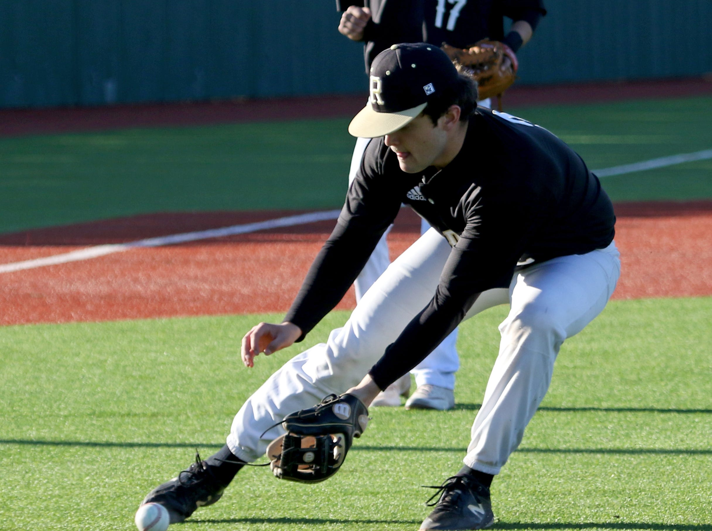 Rider's Maverick Folmar fields the grounder in the game against Abilene Cooper Tuesday, March 5, 2019, at Hoskins Field.