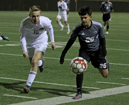 Wichita Falls High School's Julio Vasquez and Aledo's Tyler Oetinger run as the ball goes out of bounds Tuesday, March 5, 2019, at Memorial Stadium.