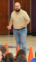 Oncor presenter, Jason Villarreal talked to 5th-grade students at Southern Hills Elementary about being safe around electricity during Oncor's child safety roadshow, Wednesday afternoon.