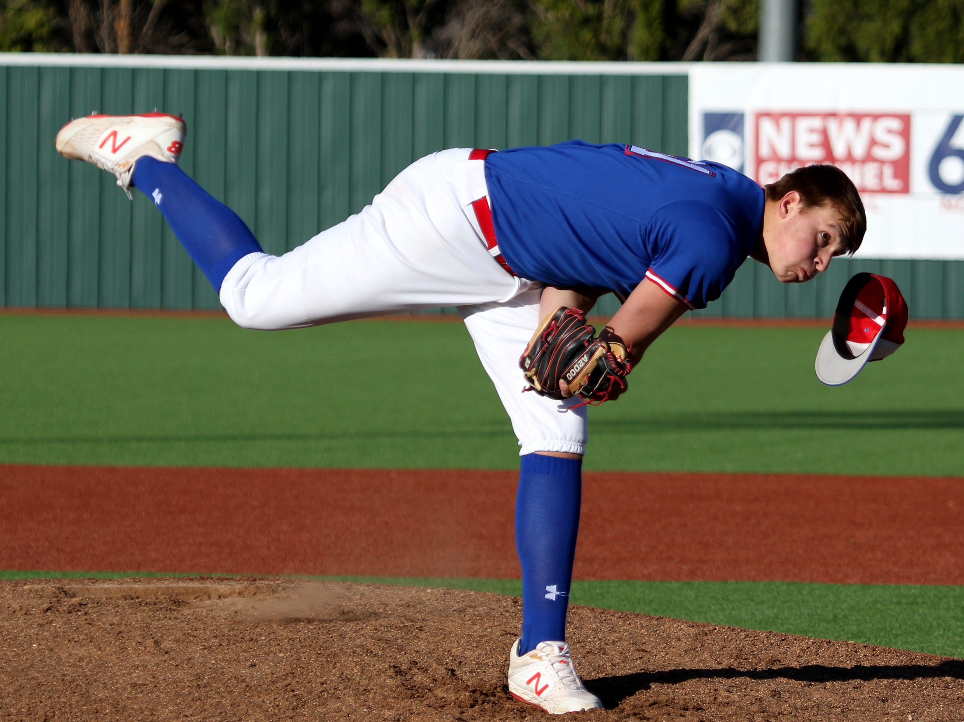 Abilene Cooper's Braiden Hill loses his hat as he pitches against Rider Tuesday, March 5, 2019, at Hoskins Field.