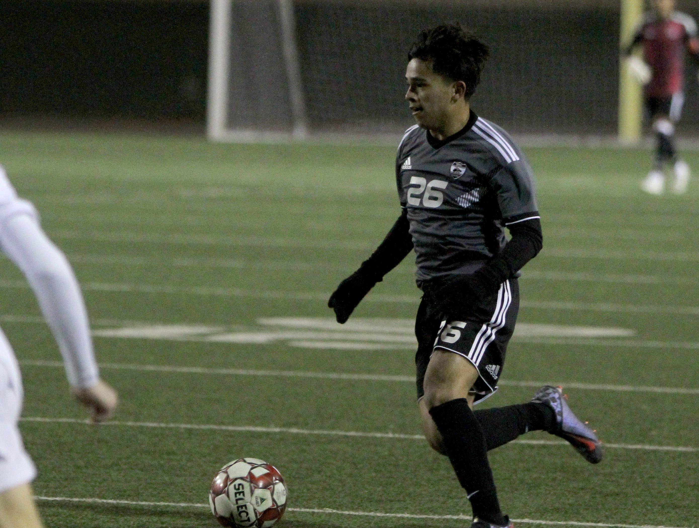 Wichita Falls High School's Julio Vasquez dribbles in the match against Aledo Tuesday, March 5, 2019, at Memorial Stadium.