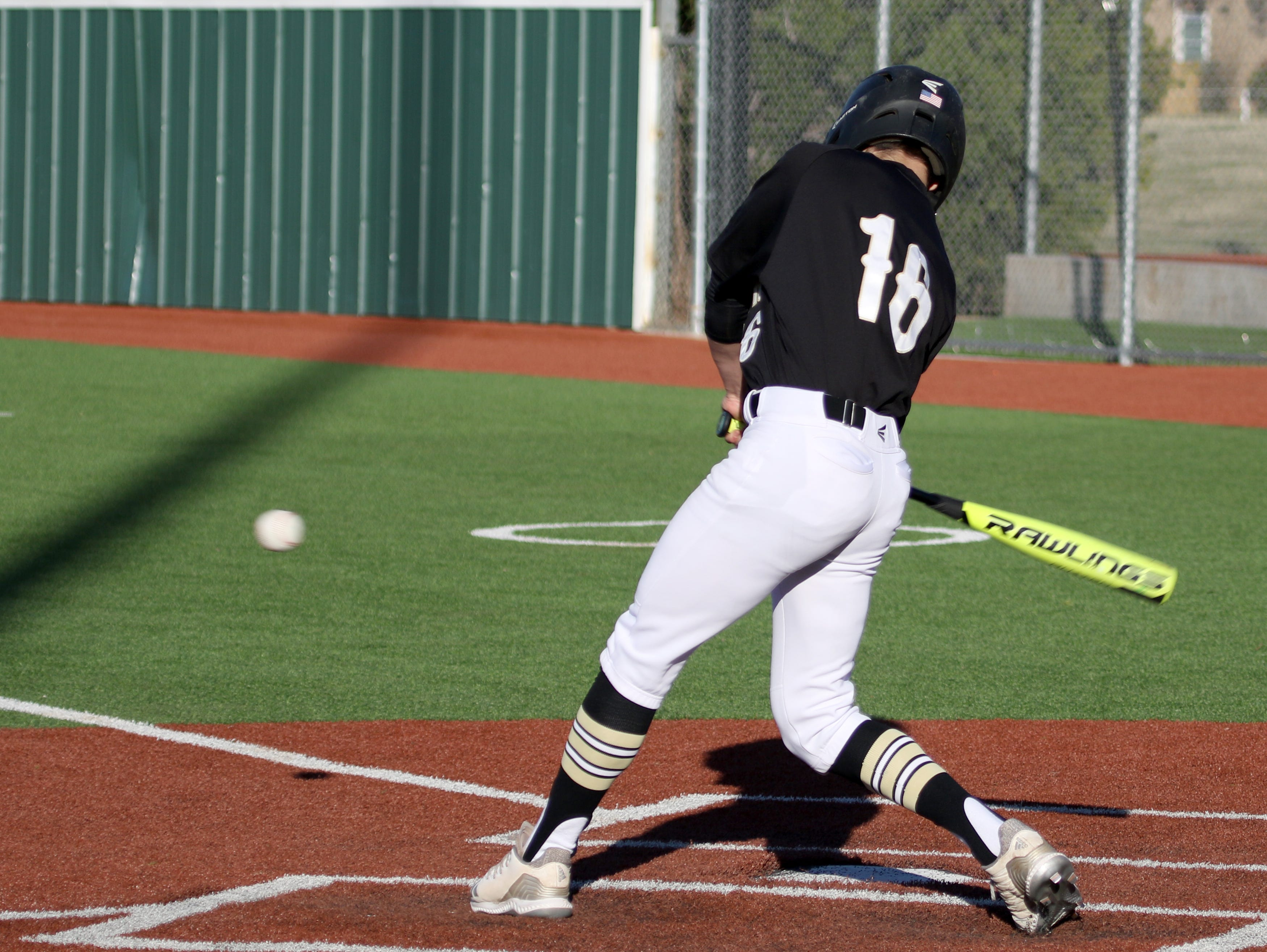 Rider's Justin Marsh makes contact in the game against Abilene Cooper Tuesday, March 5, 2019, at Hoskins Field.
