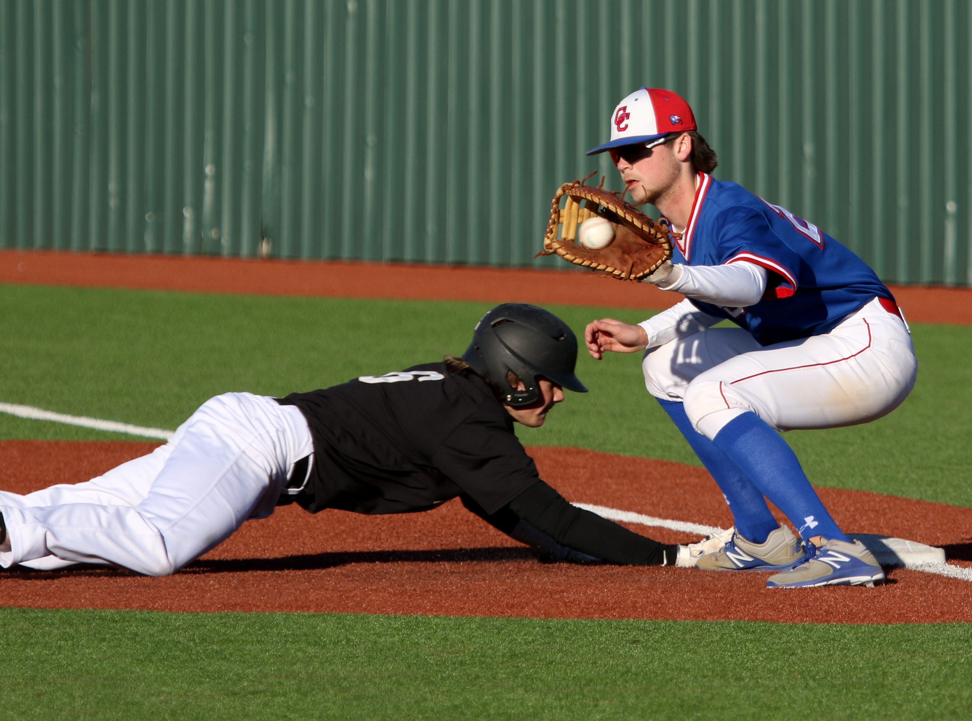 Rider's Ranse Radtke slides back into first under Abilene Cooper's JD Creel Tuesday, March 5, 2019, at Hoskins Field.