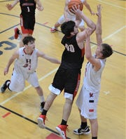 Rosecrans' Matt Applegate shoots over a Berlin Hiland defender in Tuesday's 48-39 loss to the Hawks in a Division IV district semifinal.