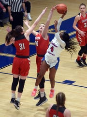 Freshman Faith Stinson blocks the shot of Samaria Rodgers-Gossett during the first quarter of Sheridan's 59-44 win against Columbus Eastmoor in a Division II regional semifinal at Winland Memorial Gymnasium.