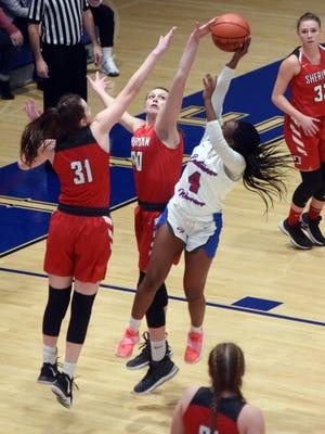 Freshman Faith Stinson blocks the shot of Samaria Rodgers-Gossett during the first quarter of Sheridan's 59-44 win against Columbus Eastmoor in a Division II regional semifinal at Winland Memorial Gymnasium.