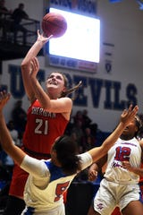 Kendyl Mick goes up for a shot in the lane during Sheridan's 59-44 win against Columbus Eastmoor on Tuesday at Winland Memorial Gymnasium.