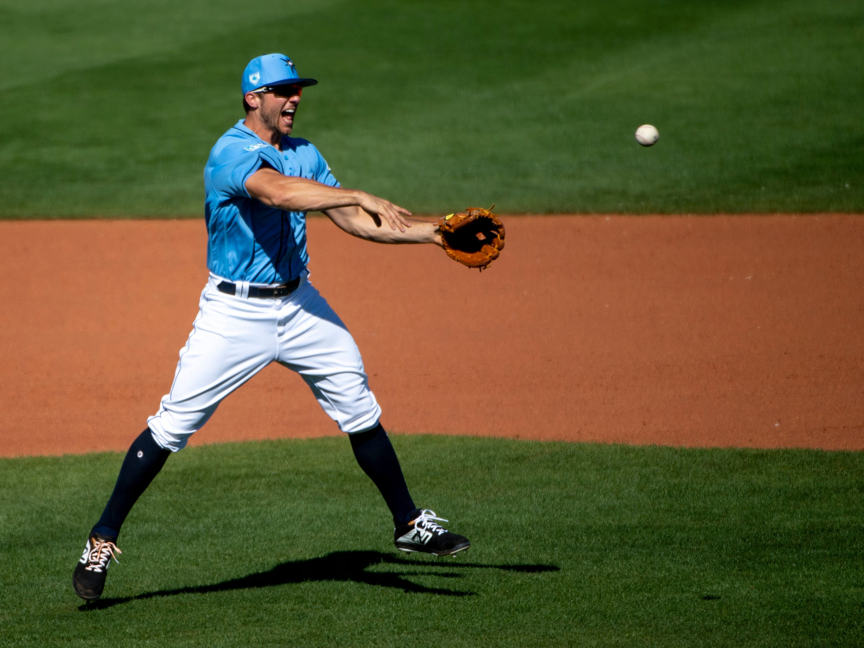 March 2: Rays infielder Kevin Padlo fields a ball from Phillies shortstop Malquin Canelo.