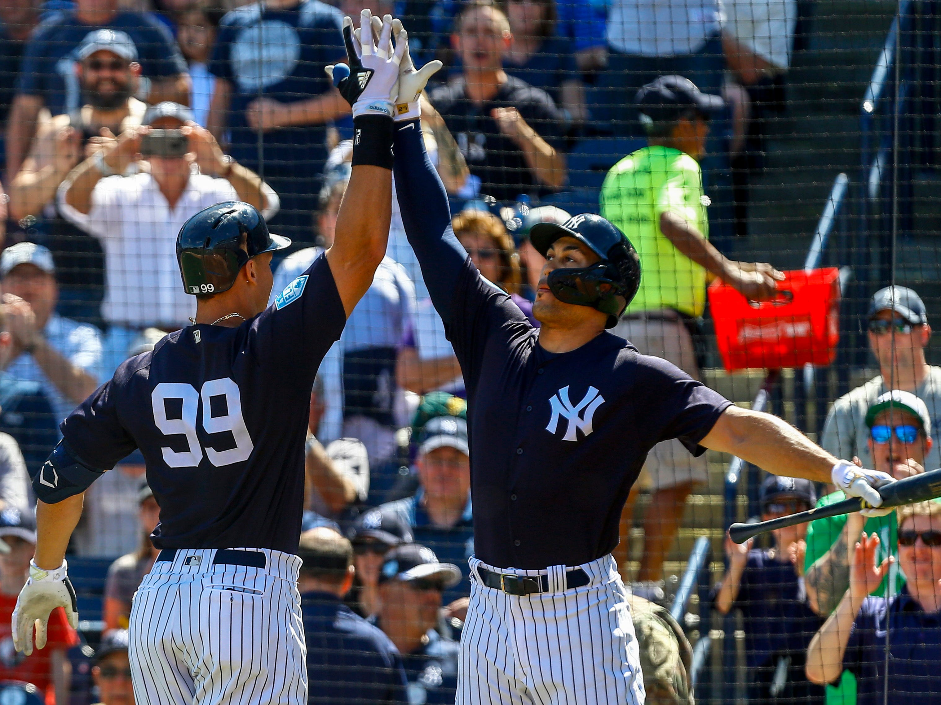 March 3: Yankees right fielder Aaron Judge celebrates with left fielder Giancarlo Stanton (right) after hitting a home run.