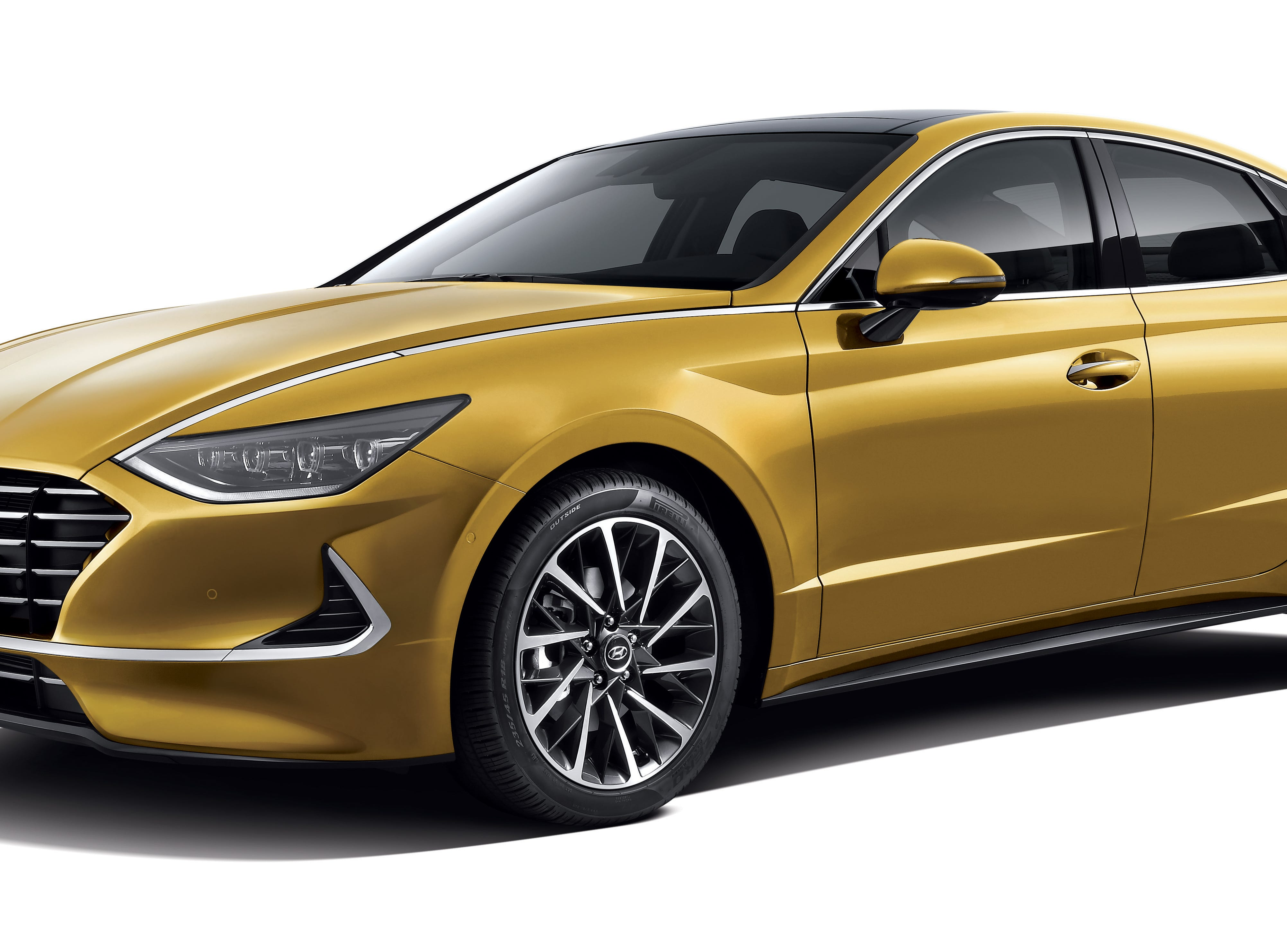 The mid-size sedan brings an Aston Martin-esque vibe with the yellow paint job. The large crisscross alloy wheels add sporty appeal.