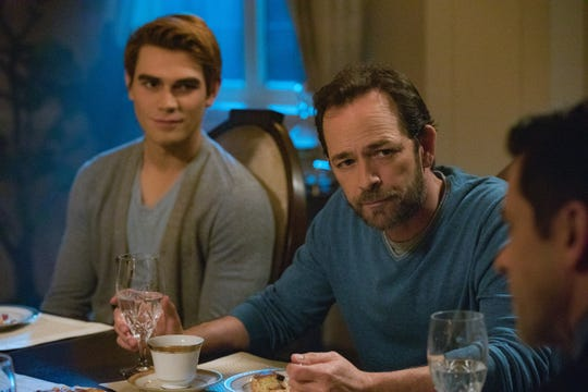 Luke Perry, center facing camera, plays Fred Andrews, the father of Archie (KJ Apa, left), in CW's 'Riverdale.' Perry's Fred will appear in Wednesday's episode, the first to be broadcast since his death on Monday.