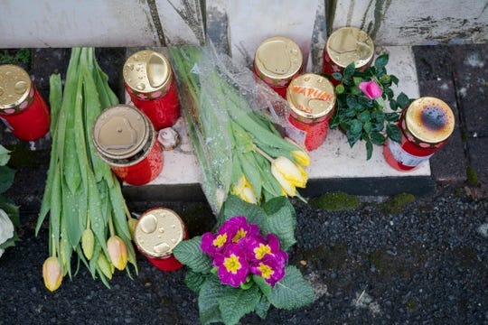 Flowers are set at a house of a doctor, who died in an explosion by a booby trap in Enkenbach-Alsenborn, Germany.