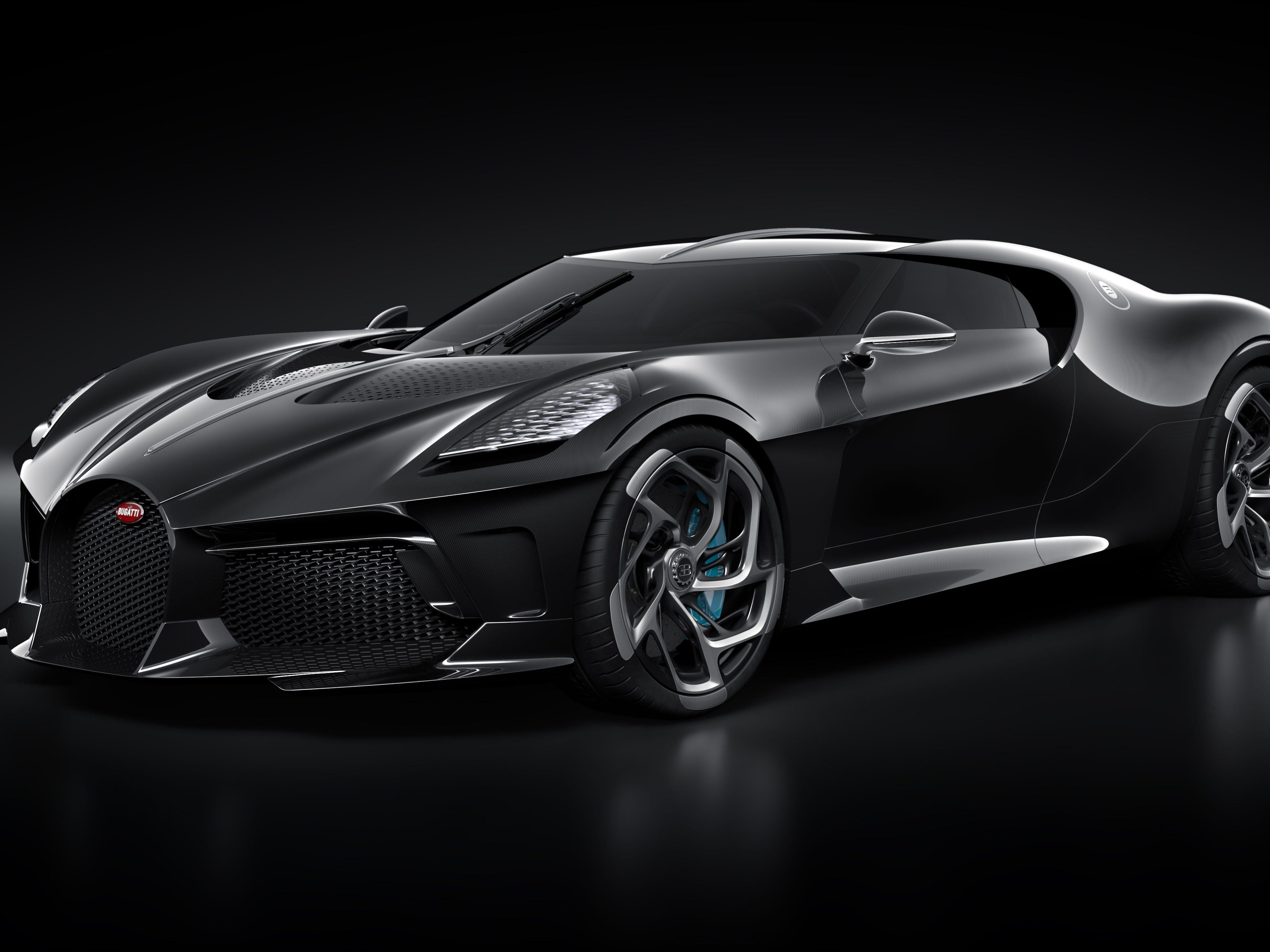 The two-door car looks like a Batmobile.