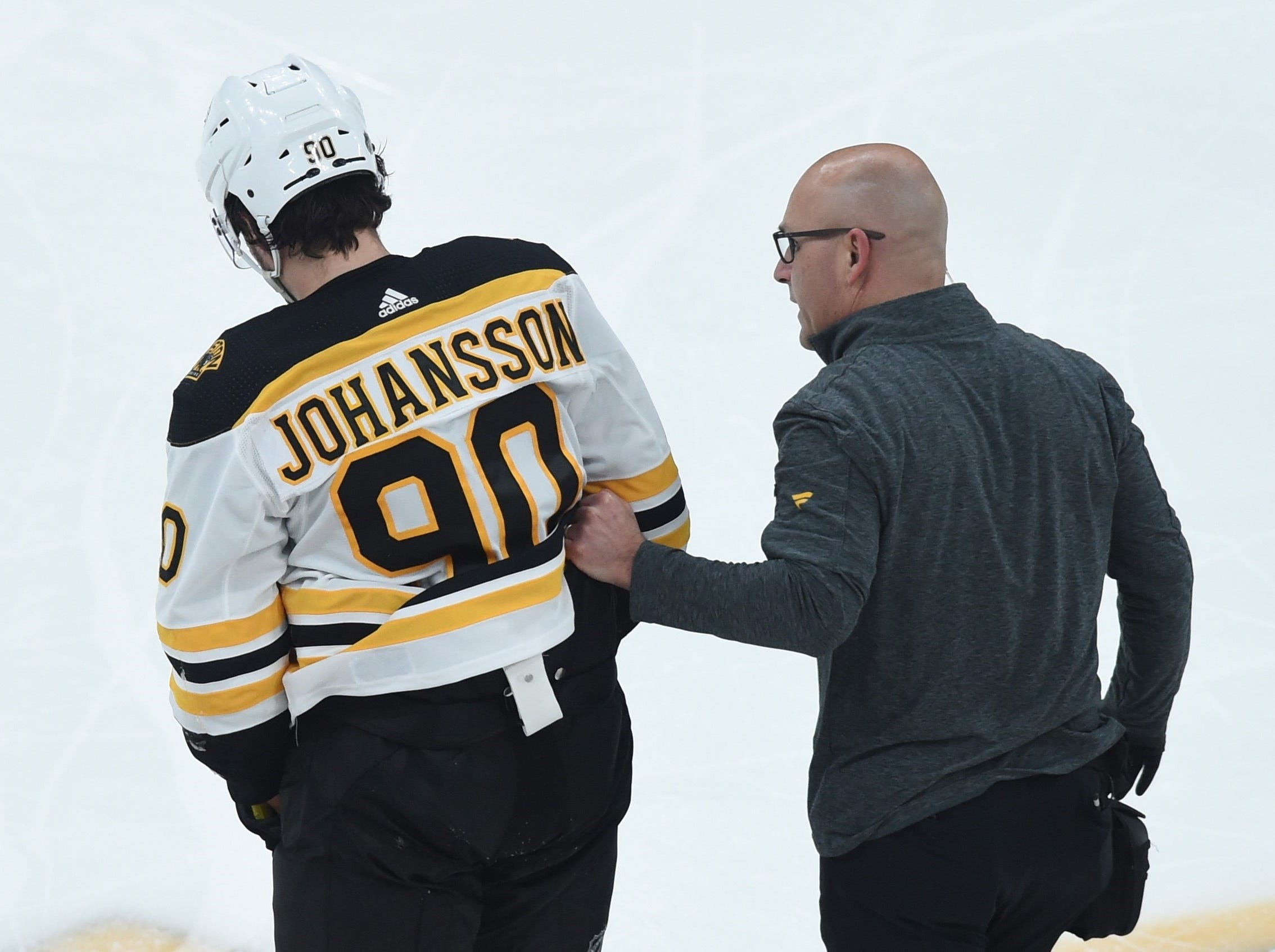March 5: Boston Bruins left wing Marcus Johansson is helped off the ice after a major hit from the Carolina Hurricanes' Micheal Ferland. He went to the hospital for tests.
