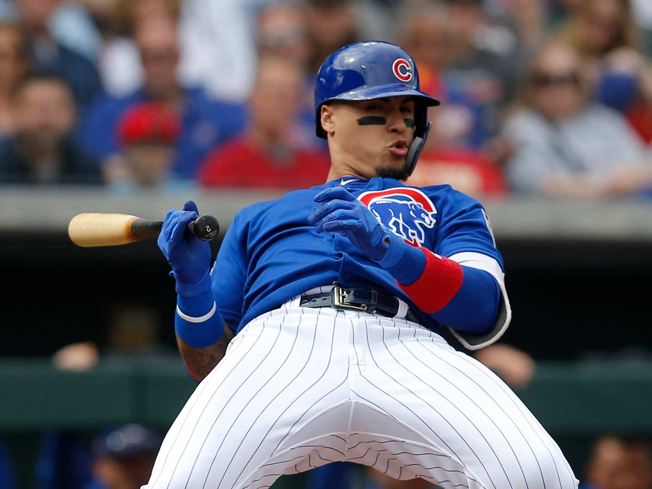March 2: Cubs shortstop Javier Baez  reacts after almost getting hit with a pitch.