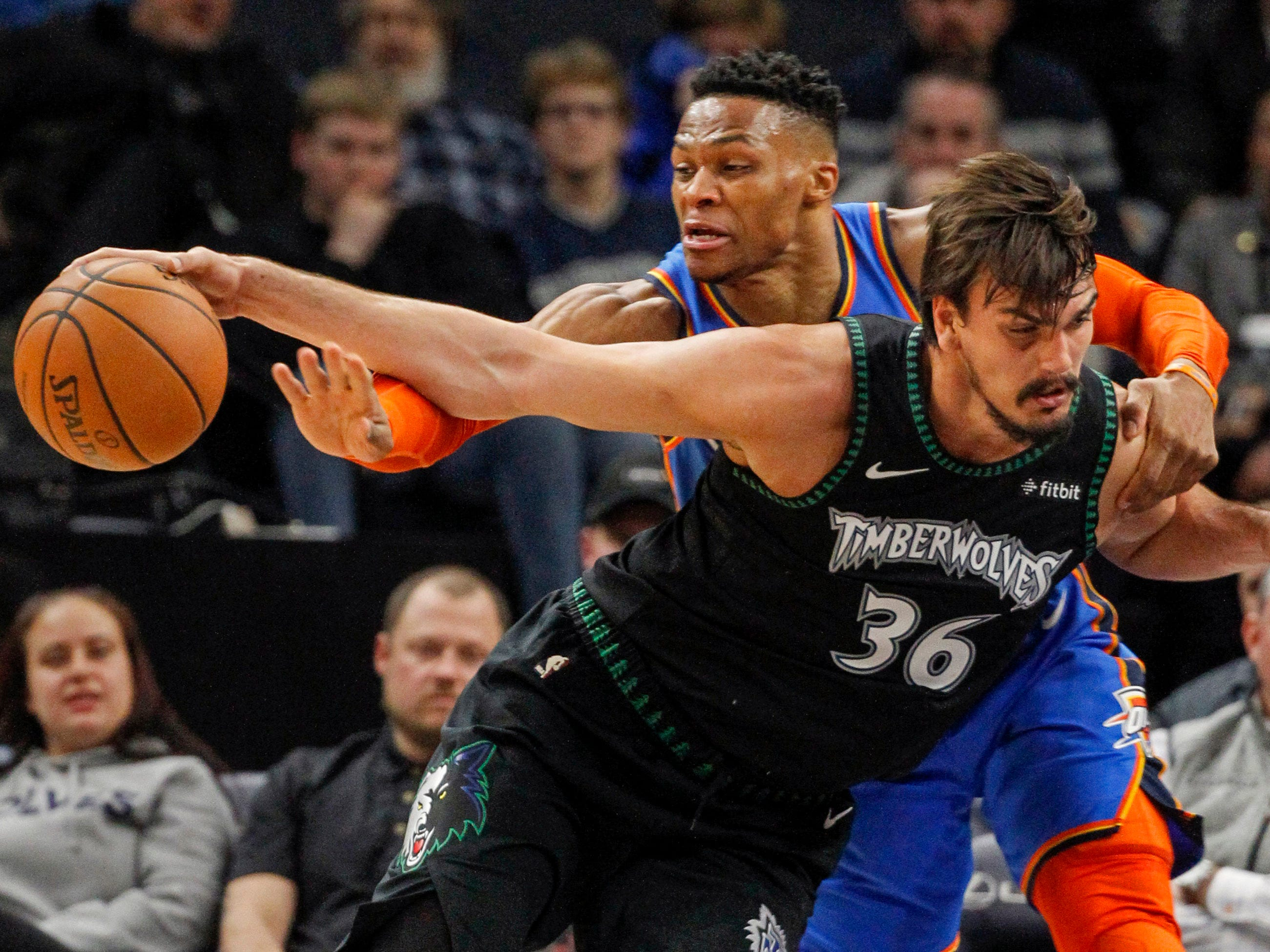 March 5: Oklahoma City Thunder guard Russell Westbrook (0) reaches for the ball that Minnesota Timberwolves forward Dario Saric (36) dribbles in the first quarter at Target Center. The Timberwolves won the game, 131-120.