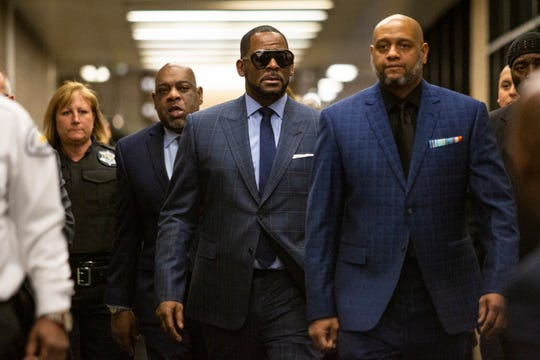 R. Kelly arrives at court for a hearing in his child support case at the Daley Center, March 6, 2019, in Chicago.