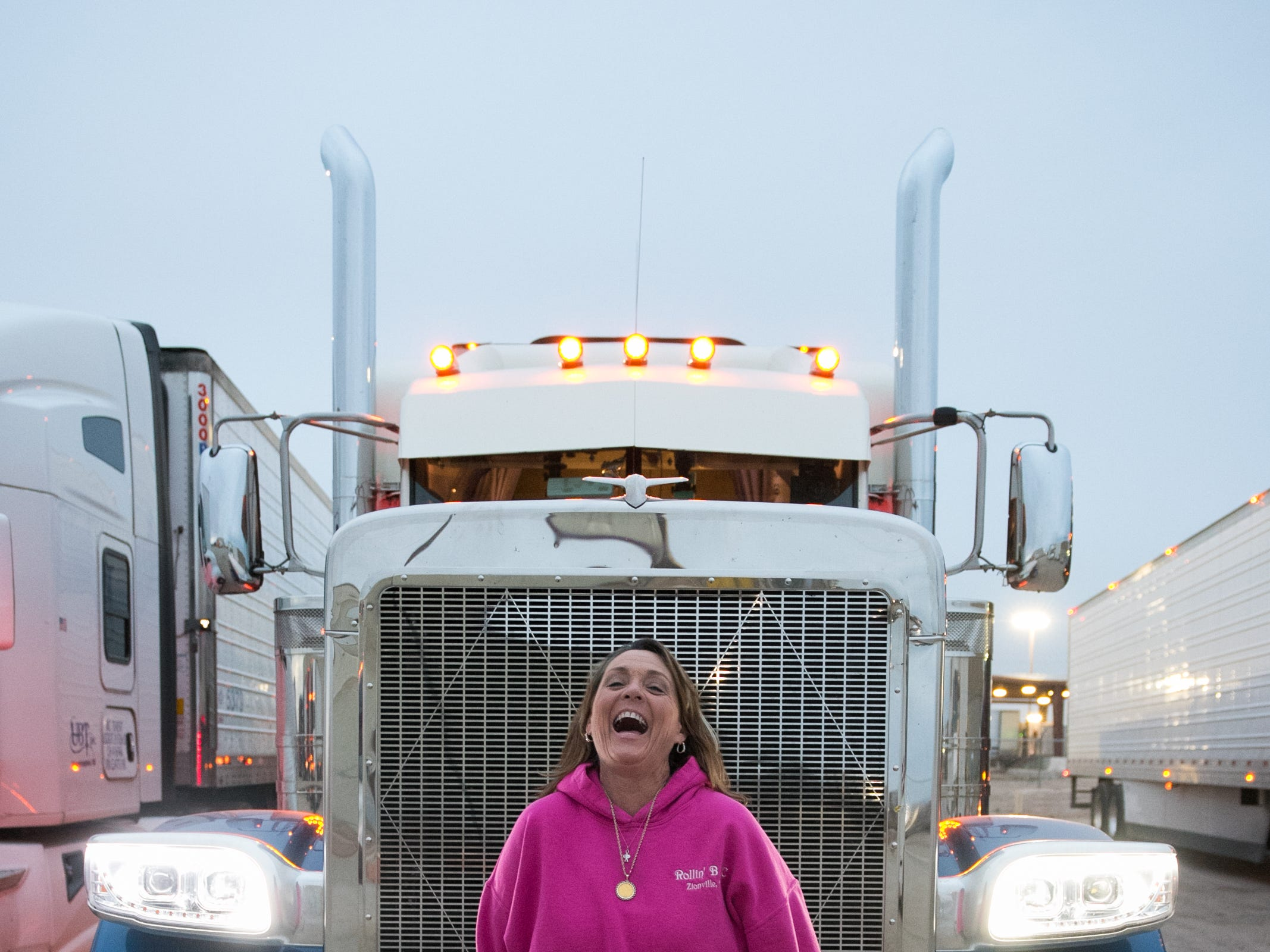 """Ingrid Brown with """"Big Faith,"""" her big-rig truck. Data shows women truck drivers aregenerallysafer than men. Experts think it's because they are less likely to take risks."""