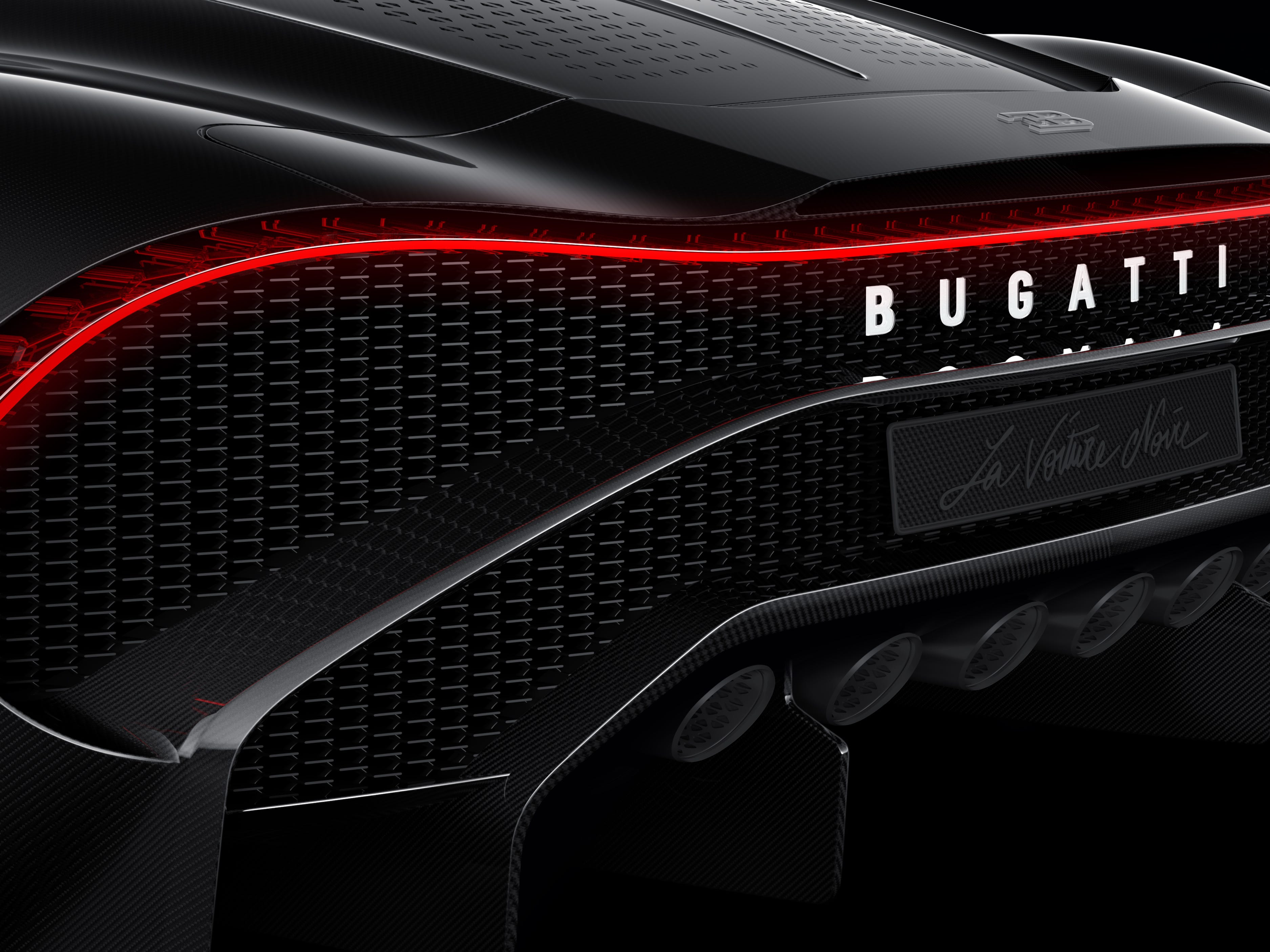 The Bugatti's six exhaust pipes speak to a market for power and noise.