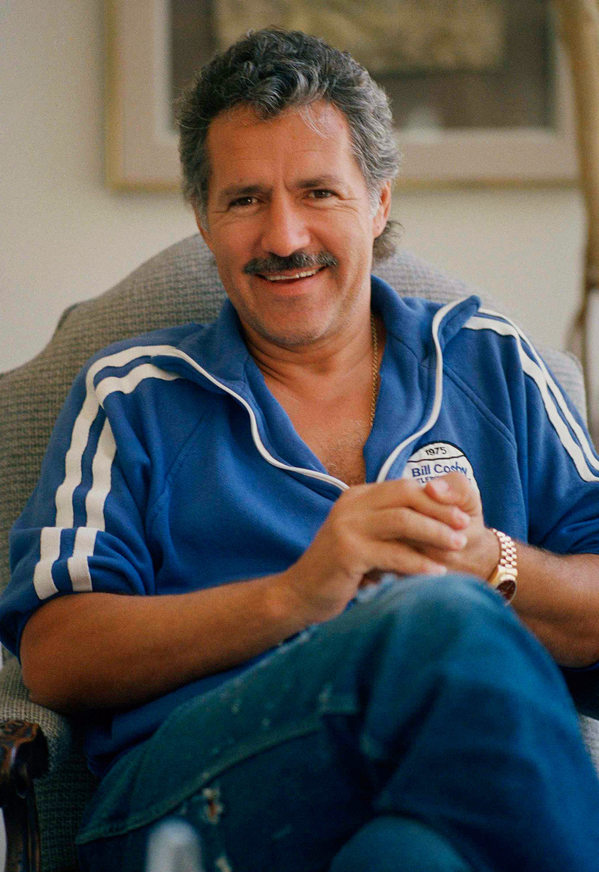 "Alex Trebek is the host of TV game shows ""Jeopardy!"" and ""Concentration"". He was photographed in his home on Mullholland Dr. in Los Angeles on July 7, 1988."