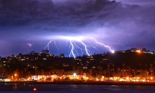 This time exposure photo provided by the Santa Barbara County Fire Department shows a series of lightning strikes over Santa Barbara, Calif., seen from Stearns Wharf in the city's harbor, Tuesday evening, March 5, 2019. A storm soaking California on Wednesday could trigger mudslides in wildfire burn areas where thousands of residents are under evacuation orders, authorities warned. Mike Eliason/Santa Barbara County Fire Department via AP) ORG XMIT: LA222