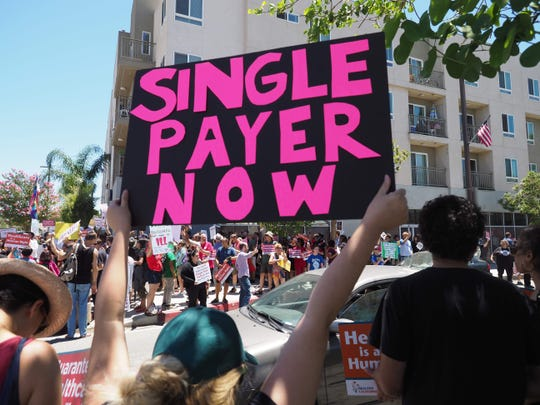 People rally in favor of single-payer health care in South Gate, California, in June 2017.
