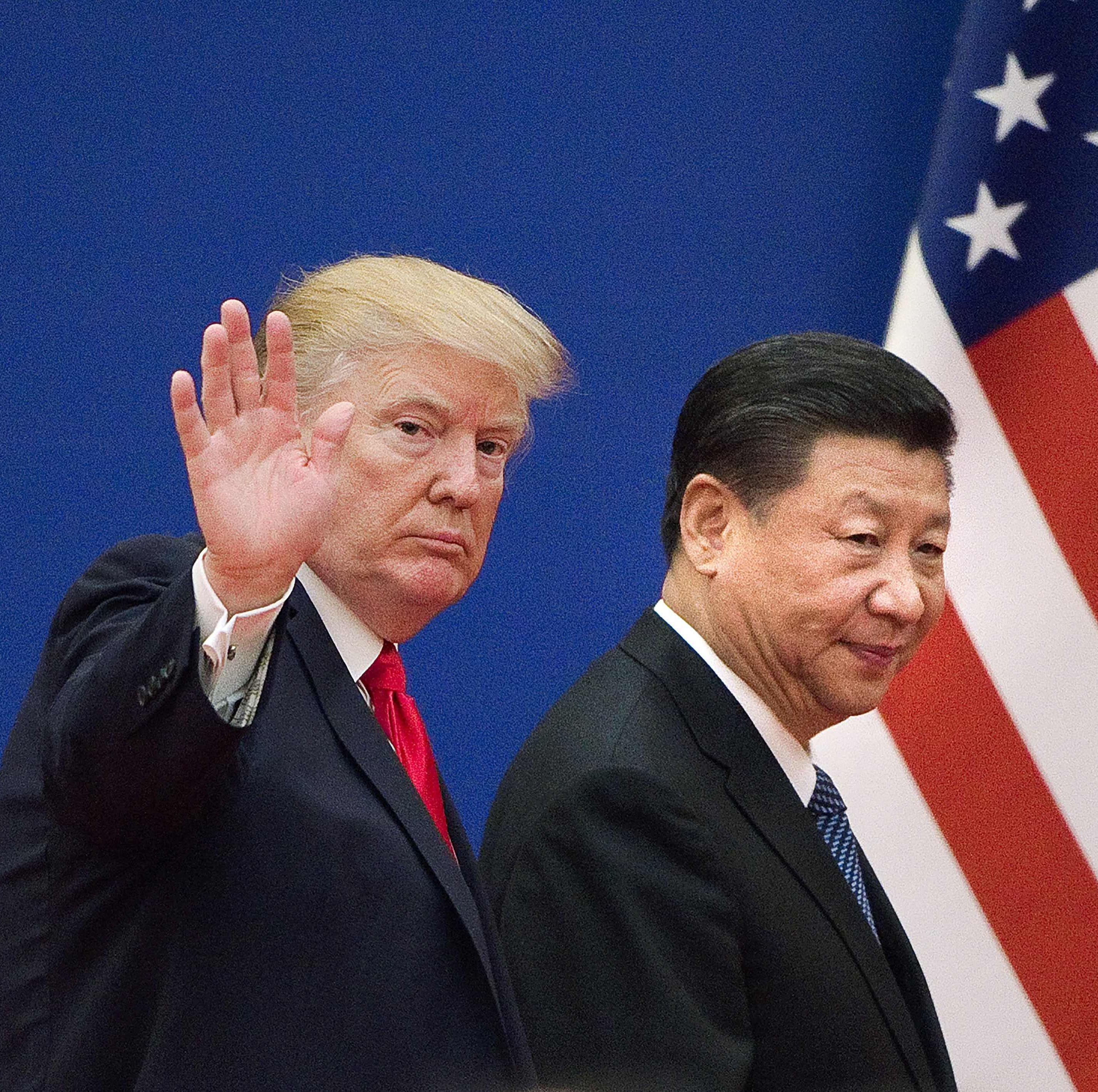 """(FILES) This file picture taken on November 9, 2017 shows US President Donald Trump (L) and China's President Xi Jinping leaving a business leaders event at the Great Hall of the People in Beijing. - US President Donald Trump on March 1, 2019, urged China to abolish tariffs on agricultural products imported from the United States -- adding that trade talks between the rival powers were going well. """"I have asked China to immediately remove all Tariffs on our agricultural products (including beef, pork, etc.),"""" the president wrote on Twitter. (Photo by Nicolas ASFOURI / AFP)NICOLAS ASFOURI/AFP/Getty Images ORIG FILE ID: AFP_1E382Y"""