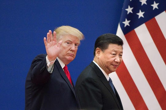 US President Donald Trump (L) and China's President Xi Jinping leaving a business leaders event at the Great Hall of the People in Beijing.