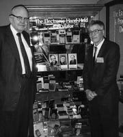 This 1997 photo taken by Phyllis Merryman shows Jack Kilby and Jerry Merryman, right, at the American Computer Museum in Bozeman, Montana. Kilby, Merryman and James Van Tassel are credited with having invented the handheld calculator while working at Dallas-based Texas Instruments.