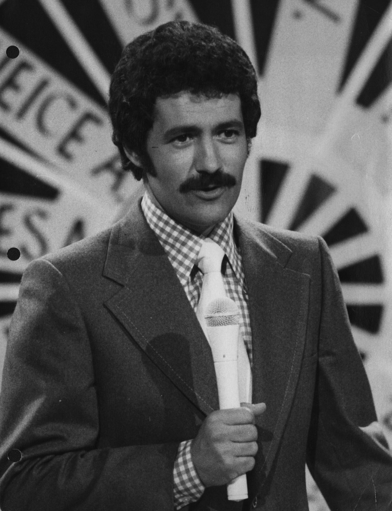 "Alex Trebek in 1973, hosting ""Wizard of Odds"" for NBC. He has hosted ""Jeopardy!"" since its premier in 1984."