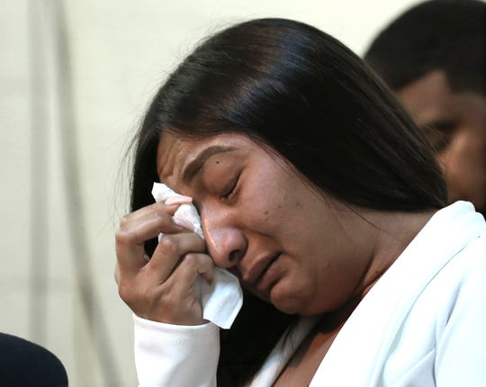 Salena Manni, the fiancee of Stephon Clark, wipes tears from her eyes during a news conference. Sacramento prosecutors determined that no charges would be filed against officers for the shooting death of Clark, a 22-year-old black man who was killed by police in his grandmother's back yard.