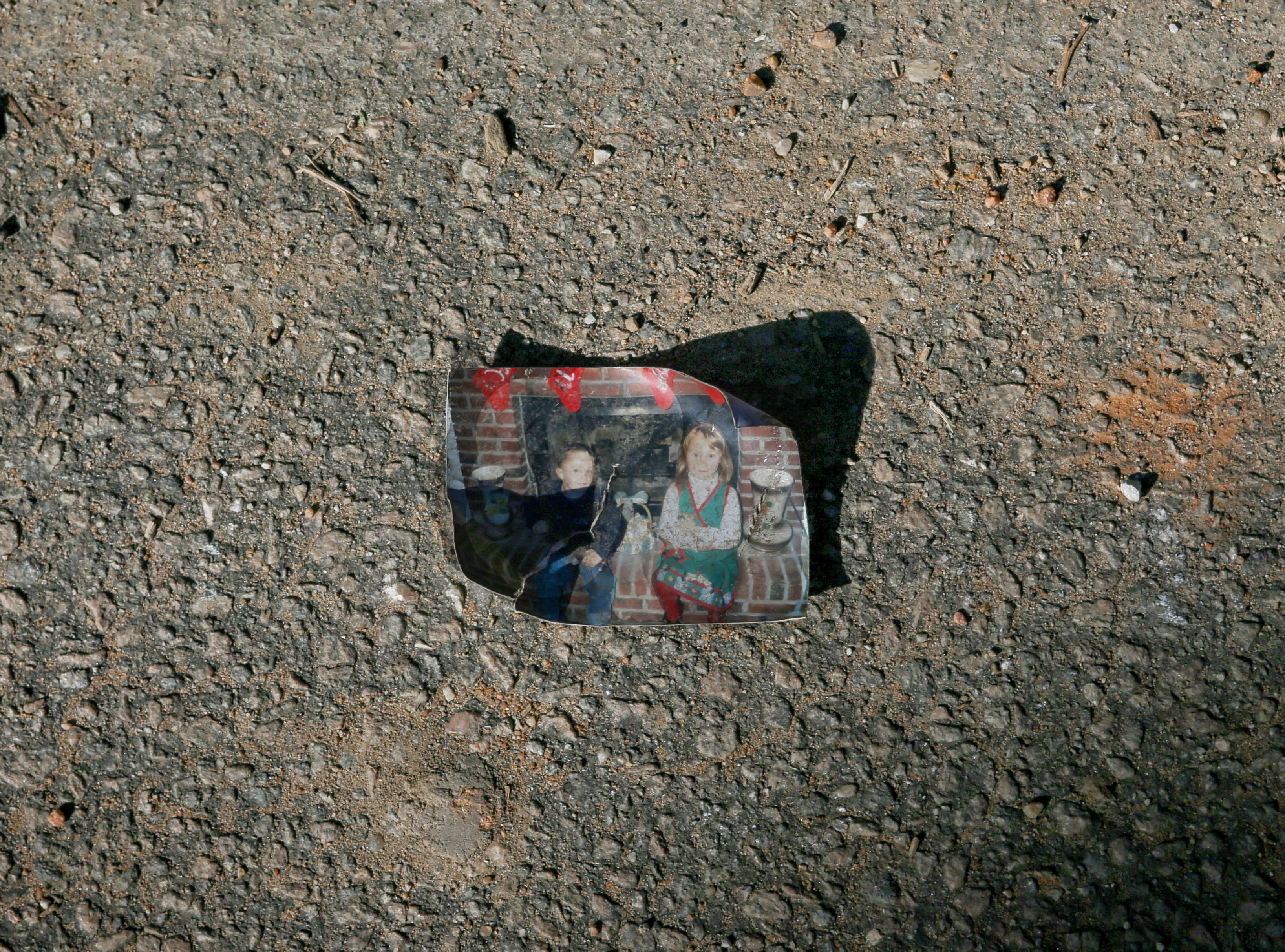 A family photo lays in the street in Beauregard, Ala. on March 6, 2019.
