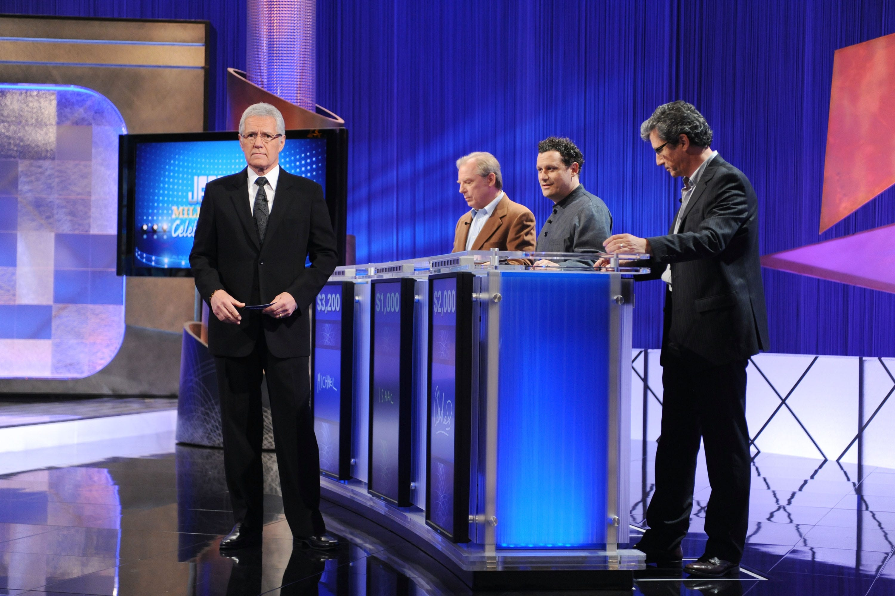 "Game show host Alex Trebek greets celebrity contestants Michael McKean, Isaac Mizrahi and Charles Shaughnessy on the set of the ""Jeopardy!"" Million Dollar Celebrity Invitational Tournament Show Taping on April 17, 2010 in Culver City, Calif."