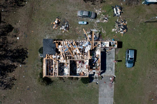 Drone photo of a home along Route 165 in Beauregard, Alabama is damaged during the Sunday tornadoes.