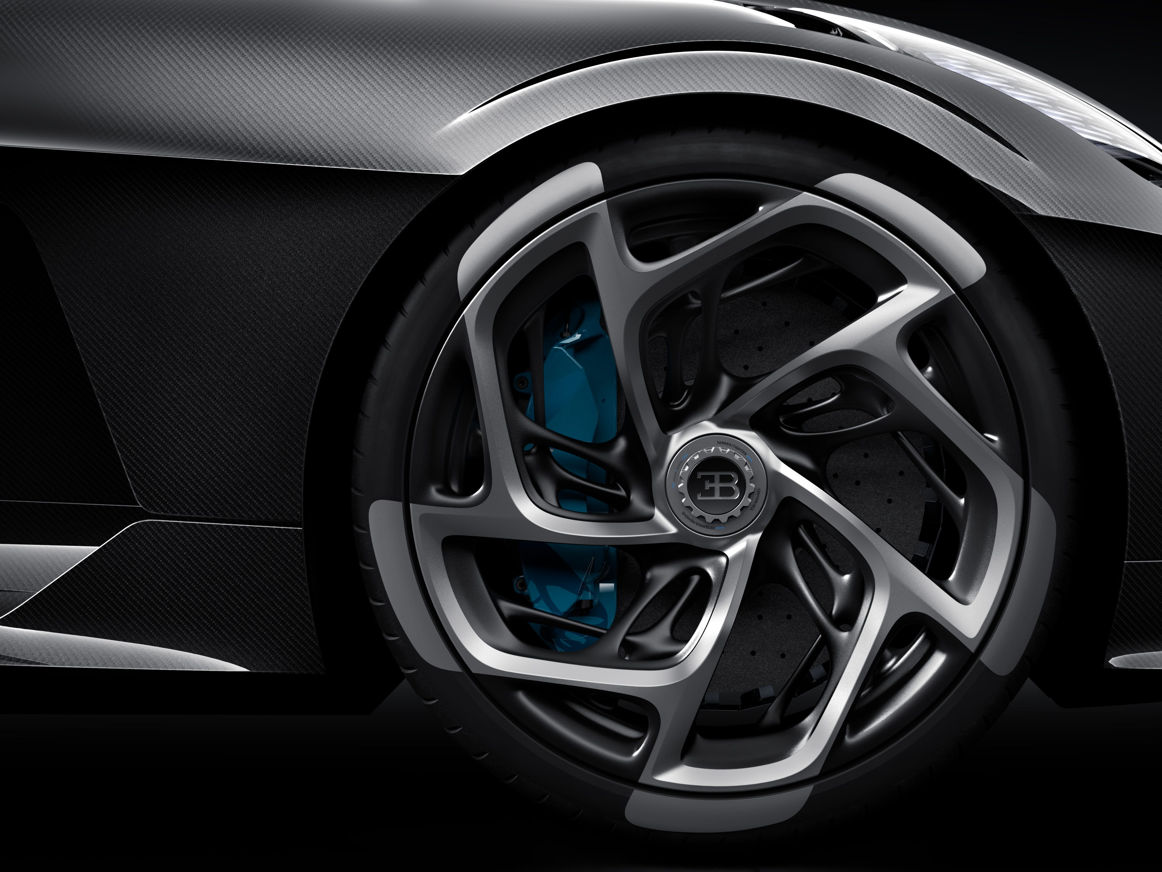 Teal brake calipers add a pop of color to the black-on-black sports car.