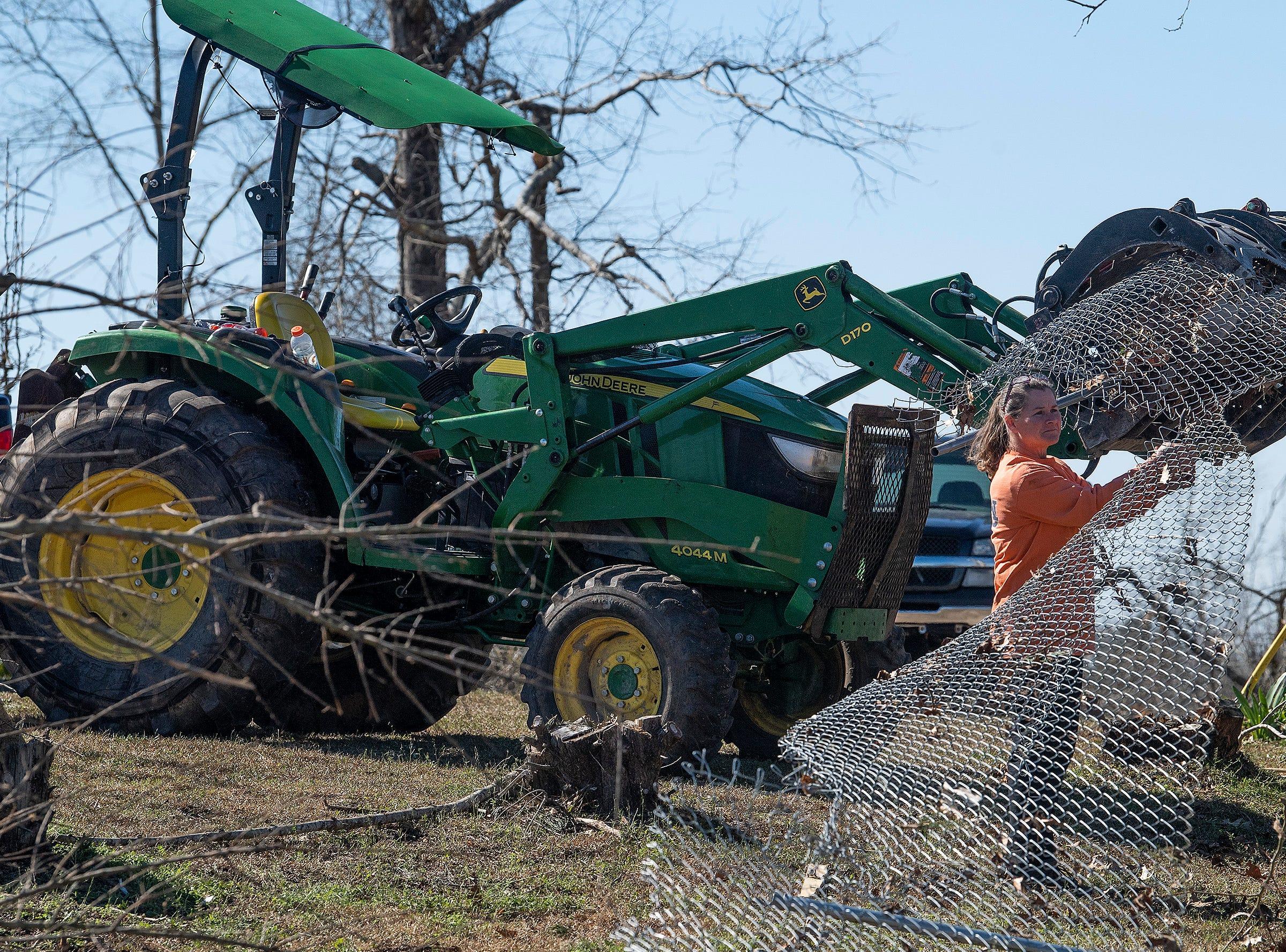 Residents clear debris in Beauregard, Ala., on March 6, 2019.