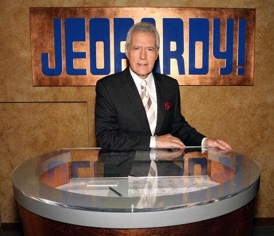 Host Alex Trebek poses on Sony Pictures set for the premiere of the 28th season of the TV show