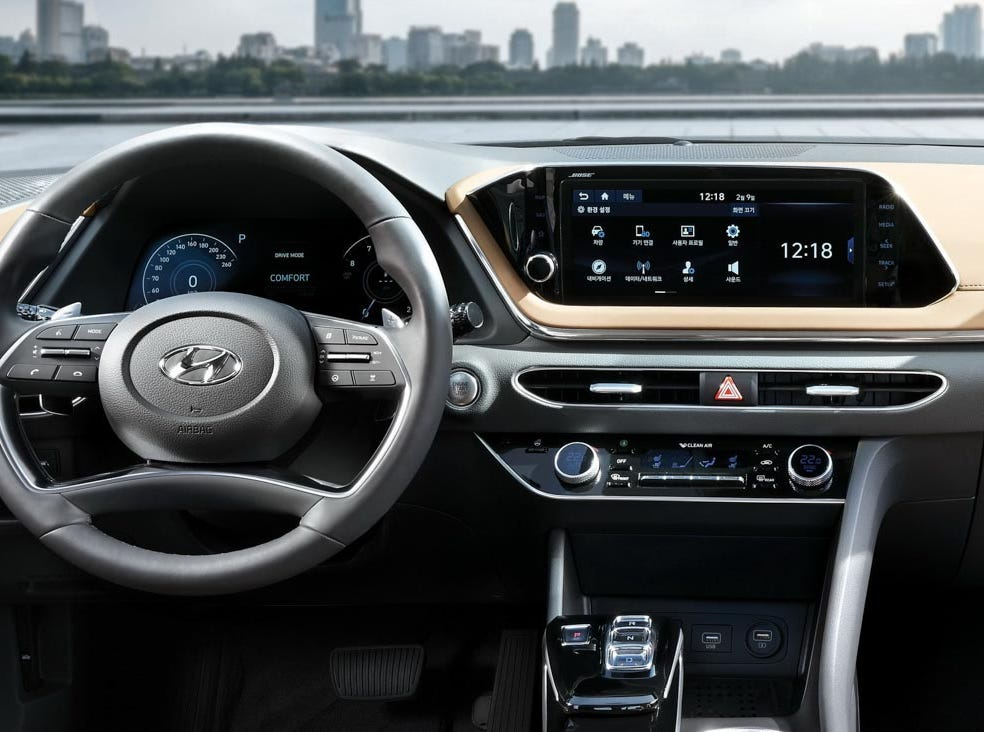 Additional features include a satin chrome accent on the steering wheel, and shift-by-wire transmission controls.