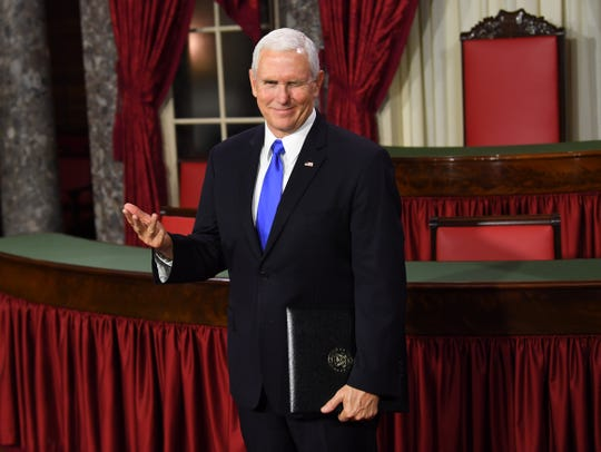 Vice President Mike Pence winks as he officiates ceremonial swearing-ins of senators in the Old Senate Chamber at the U.S. Capitol in Washington, D.C., on Jan. 3, 2019.