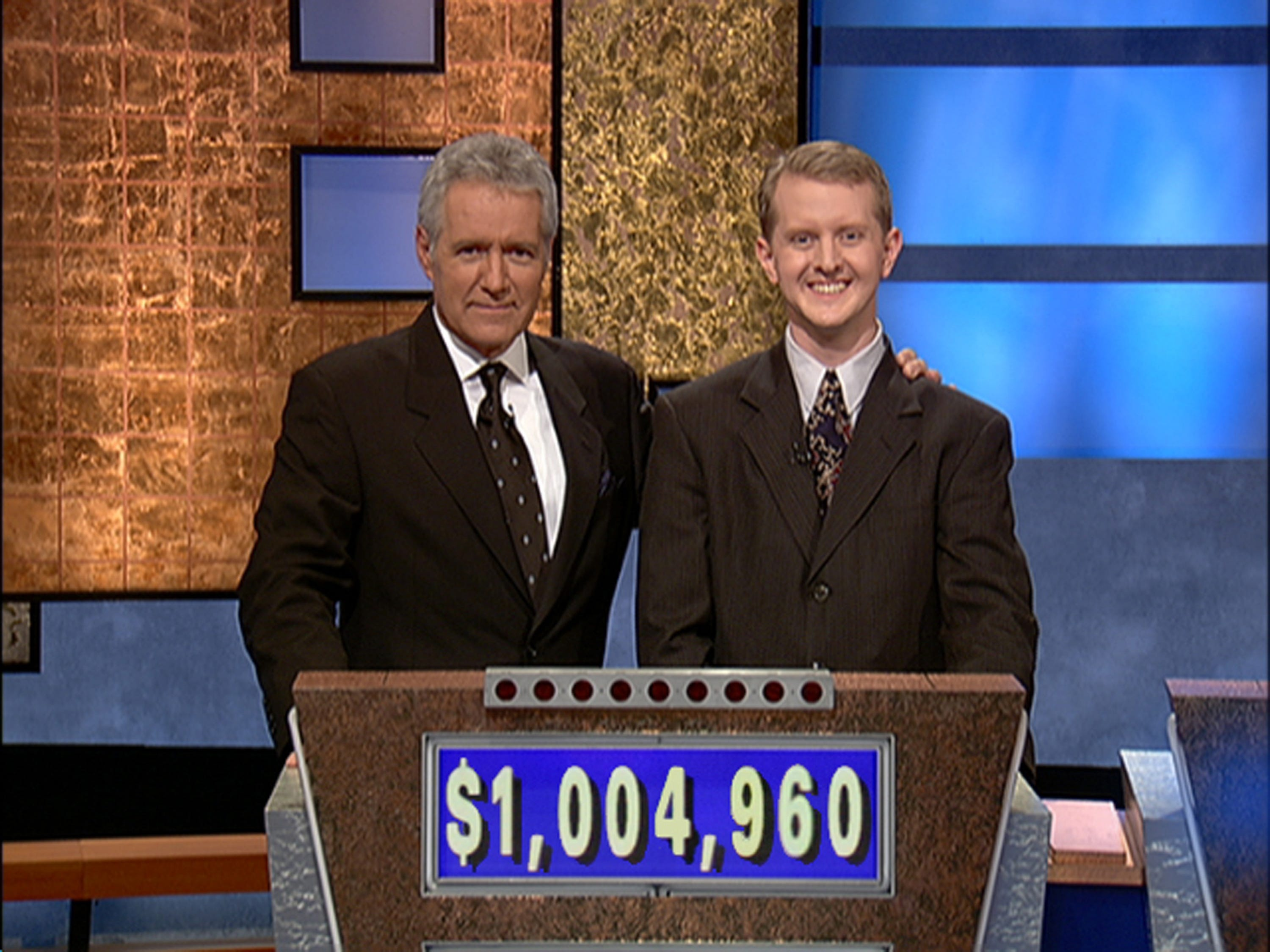Jeopardy host Alex Trebek poses contestant Ken Jennings after his earnings from his record breaking streak on the gameshow surpassed 1 million dollars July 14, 2004 in Culver City, Calif.