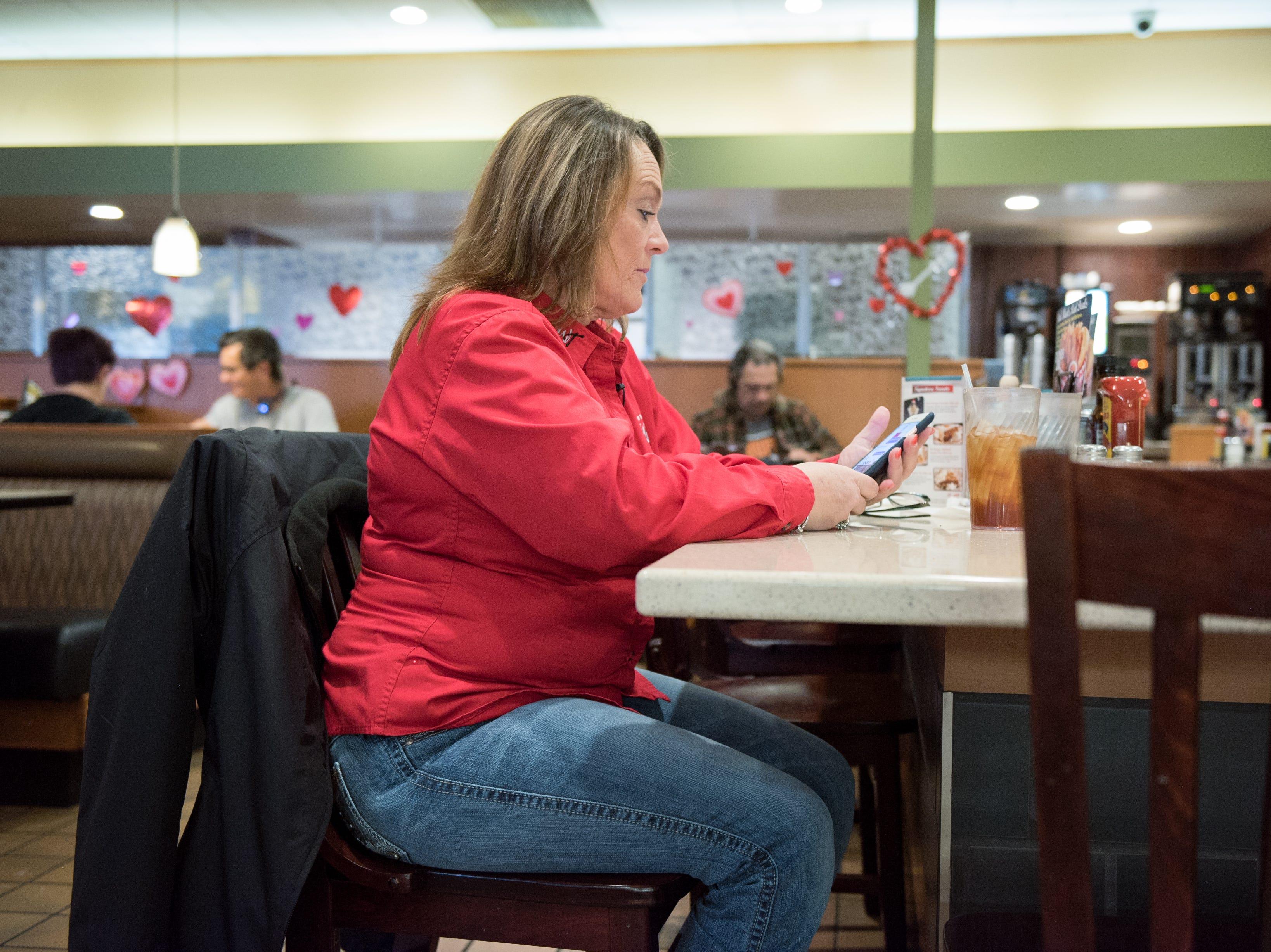 Ingrid Brown orders breakfast at a truck stop diner outside of Los Angels.
