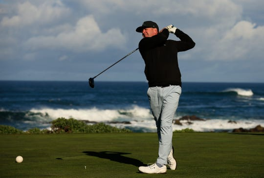 Tony Romo plays his shot from the 13th tee during the AT&T Pebble Beach Pro-Am in February.